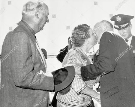 Dwight D. Eisenhower, W. Alton Jones Mrs. W. Alton Jones is kissed by President Eisenhower as he arrived, at nearby Turner Air Force Base in Albany, Georgia. At left is Mr. Jones, a friend of Ike, who will hunt quail with the President at Blue Springs Plantation, south of here. Looking on at right is Brig. Gen. Austin Russell of TAFB