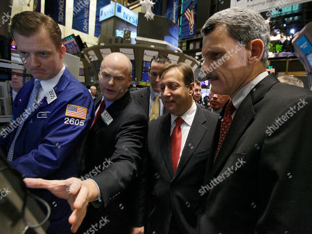Marc Rothman, Dan Moloney, Evan Solomon, Ned Zellis Marc Rothman, second right, senior vice president and CFO of Motorola Mobility, and Dan Moloney, right, president of Motorola Mobility, visit the post where their company's stock is traded on the floor of the New York Stock Exchange . Describing the operation is specialist Evan Solomon, second left, as specialist Ned Zellis manages trades