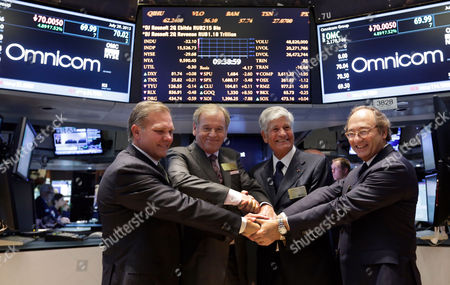 """John Wren, Maurice Levy, Randall Weisenburger, Jean-Michel Etienne Omnicom Group CFO Randall Weisenburger, left, and President and CEO John Wren, second left, join hands with Publicis Groupe Chairman and CEO Maurice Levy, third left, and CFO Jean-Michel Etienne as they pose for photos on the floor of the New York Stock Exchange . Omnicom Group Inc. and Publicis Groupe SA say they are combining in a """"merger of equals"""" that will create the world's largest advertising firm, one worth more than $35 billion"""