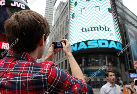 David Karp David Karp, Founder and CEO of Tumblr, photographs the Nasdaq screen in Times Square after ringing the opening bell, in New York. Yahoo acquired the online blogging forum for $1.1 billion in June. Tumblr will remain independently operated and Karp will stay CEO