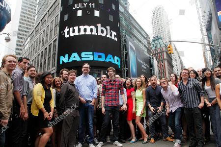 David Karp David Karp, center in plaid shirt, Founder and CEO of Tumblr, poses for photos with Tumblr employees in front of Nasdaq in Times Square after ringing the opening bell, in New York. Yahoo acquired the online blogging forum for $1.1 billion in June. Tumblr will remain independently operated and Karp will stay CEO