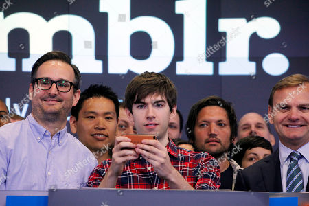David Karp David Karp, Founder and CEO of Tumblr, takes photos while posing for photos with company employees before the opening bell at Nasdaq, in New York. Yahoo acquired the online blogging forum for $1.1 billion in June. Tumblr will remain independently operated and Karp will stay CEO