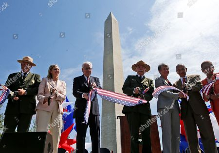 Stock Image of Robert Vogel, Caroline Cunningham, David Rubinstein, Jonathan Jarvis, Sally Jewell, John Podesta, Eleanor Holmes Norton From left to right: Robert A. Vogel, Superintendent of the National Mall and Memorial Parks; Caroline L. Cunningham, President of the Trust for the National Mall; David M. Rubinstein, co-founder and co-chief executive officer of The Carlyle Group; Jonathan B. Jarvis, Director of the National Park Service; Interior Secretary Sally Jewell; White House Counsel John Podesta, and Del. Eleanor Holmes Norton, D-D.C., cut a ribbon at the Washington Monument in Washington, during a ceremony to celebrate its re-opening. The monument, which sustained damage from an earthquake in August 2011, reopened to the public today
