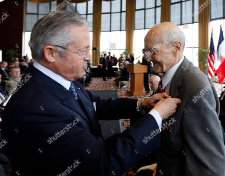Guy Wildenstein,Francis Cocca Guy Wildenstein, president of the American Society of the French Legion of Honor, left, presents an the legion's insignia to World War II veteran Francis Cocca of Green Island, N.Y., during a ceremony at the U.S. Military Academy, in West Point, N.Y. Thirty-four veterans were honored 70 years after of the D-Day landings