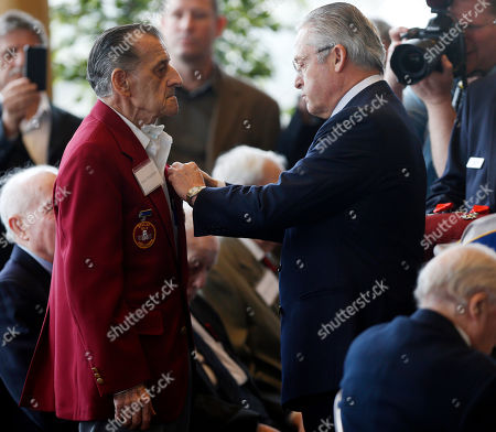 Guy Wildenstein,Emilio Vizachero Jr Guy Wildenstein, president of the American Society of the French Legion of Honor, right, presents an the legion's insignia to World War II veteran Emilio Vizachero Jr., during a ceremony at the U.S. Military Academy, in West Point, N.Y. Thirty-four U.S. veterans were honored 70 years after of the D-Day landings