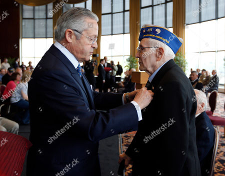 Guy Wildenstein,John Peregrim Guy Wildenstein, president of the American Society of the French Legion of Honor, left, presents an the legion's insignia to World War II veteran John Peregrim of Devon, Conn., during a ceremony at the U.S. Military Academy, in West Point, N.Y. Thirty-four veterans were honored 70 years after of the D-Day landings