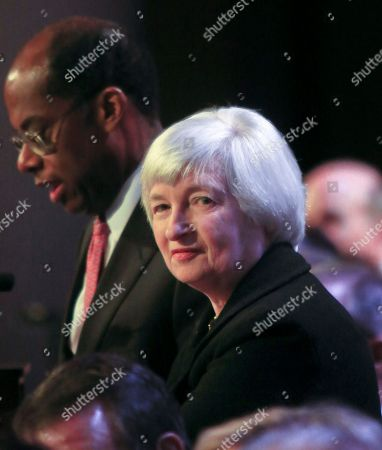Janet Yellen President and CEO of TIAA-CREF Roger Ferguson, Jr., left, president of the Economic Club speaks after Federal Reserve Chairwoman Janet Yellen, right, addressed the club's luncheon in New York