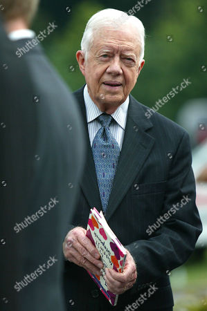 "YOUNG POET Former President Jimmy Carter holds a book written by Mattie J.T. Stepanek entitled ""Loving Through Heartsong"" during Stepanek's funeral mass at St. Catherine Laboure Catholic Church, in Wheaton, Md. President Carter was a friend tof Mattie's, who was about a month shy of his 14th birthday when he died Tuesday, June 22, of complications from muscular dystrophy"