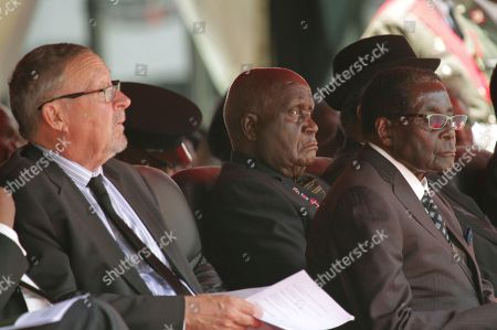 Acting Zambian President Guy Scott, left, first President of Zambia Kenneth Kaunda, centre, and Zimbabwean President Robert Mugabe attend the funeral of the late Zambian President Michael Sata in Lusaka, Tuesday, Nov, 11, 2014. Sata's funeral was held in a stadium in the country's capital Lusaka which was filled to capacity with hundreds more waiting outside the gates. Sata, 77, served as president of the Southern African country since 2011. He died in a London hospital on Oct. 28 after a long illness