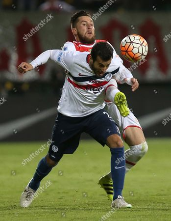 Jonathan Gomez, Raul Caceres Jonathan Gomez of Colombia's Independiente Santa Fe, back, battles for the ball with Raul Caceres of Paraguay's Cerro Porteno, left, during a Copa Sudamericana soccer match in Bogota, Colombia