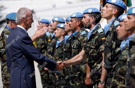 Spanish Defense Minister Pedro Morenes, shakes hands with a Spanish peacekeeper during his visit to the Spanish UN peacekeepers base, in Marjayoun, south of Lebanon, . Morenes is in Beirut to meet with the Lebanese officials and to visit the Spanish U.N. soldiers in south Lebanon