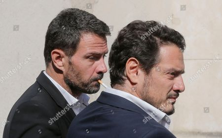 "Former trader Jerome Kerviel, left, and his lawyer David Koubbi, arrive at the Versailles appeal court, west of Paris, . A French court has cut the civil damages owed by former trader Jerome Kerviel from 4.9 billion euros ($5.5 billion) to 1 million euros ($1.1 million). Kerviel was ""partly responsible"" for huge losses suffered in 2008 by the bank Societe Generale through his reckless financial trades"