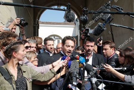 "Former trader Jerome Kerviel, right, and his lawyer David Koubbi, talk to media at the Versailles appeal court, west of Paris, . A French court has cut the civil damages owed by former trader Jerome Kerviel from 4.9 billion euros ($5.5 billion) to 1 million euros ($1.1 million). Kerviel was ""partly responsible"" for huge losses suffered in 2008 by the bank Societe Generale through his reckless financial trades"