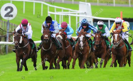 Downpatrick TORNADO WATCH & Mikey Fogarty (2 shades of blue) race to the last to win the Warm Welcome Handicap Hurdle from NATIVE LASS & Barry Browne (black cap).
