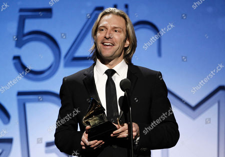 Eric Whitacre Eric Whitacre accepts the award for choral performance at the 54th annual GRAMMY Awards pre-show on in Los Angeles