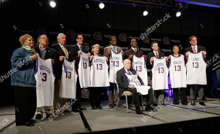 Stock Photo of Jerry Tarkanian, Richard Guerin, Russ Granik, Sylvia Hatchell, Bernard King, Gary Payton, Rick Pitino, Dawn Staley, Jim Nantz Members of the 2013 Naismith Memorial Basketball Hall of Fame class line up for a photo after inductee announcements, in Atlanta, Georgia. Shown standing behind Jerry Tarkanian from left are Edwin and Nikki Henderson representing Dr. E.B. Henderson, Richard Guerin, Russ Granik, Sylvia Hatchell, Bernard King, Gary Payton, Rick Pitino, Dawn Staley, and CBS announcer Jim Nantz representing Guy Lewis