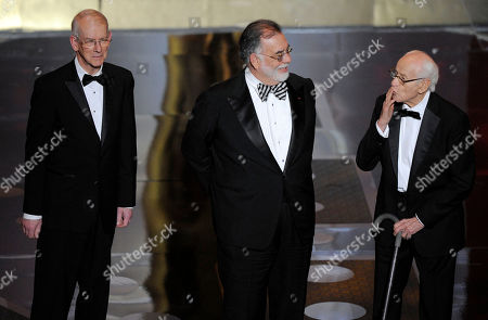Stock Photo of Kevin Brownlow, Francis Ford Coppola From left, film historian and preservationist Kevin Brownlow, director, producer, screenwriter, and Irving G. Thalberg Memorial Award recipient Francis Ford Coppola, and actor Eli Wallach are seen onstage accepting the governors awards during the 83rd Academy Awards, in the Hollywood section of Los Angeles