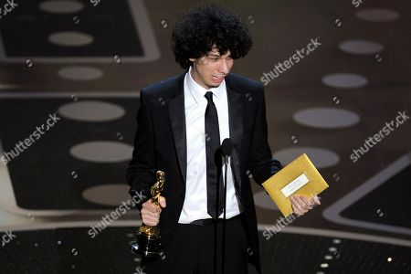 "Luke Matheny accepts the Oscar for best live action short film for ""God of Love"" at the 83rd Academy Awards, in the Hollywood section of Los Angeles"