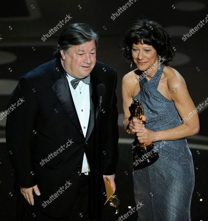 "Karen Goodman and Kirk Simon accepts the Oscar for best documentary short subject for ""Strangers No More"" at the 83rd Academy Awards, in the Hollywood section of Los Angeles"