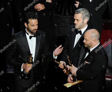 """Iain Canning, left to right, Emile Sherman and Gareth Unwin accept the Oscar for best motion picture for """"The King's Speech"""" at the 83rd Academy Awards, in the Hollywood section of Los Angeles"""