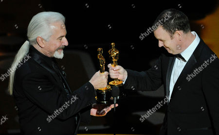 """Rick Baker, left, and Dave Elsey accept the Oscar for best makeup for """"The Wolfman"""" at the 83rd Academy Awards, in the Hollywood section of Los Angeles"""