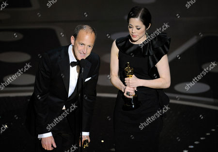 """Charles Ferguson, Audrey Marrs Producers Charles Ferguson, left, and Audrey Marrs accept the award for best documentary feature for """"Inside Job"""" during the 83rd Academy Awards, in the Hollywood section of Los Angeles"""