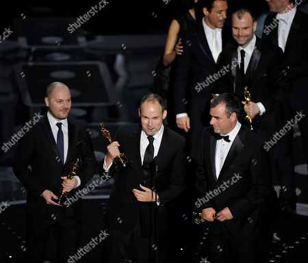"""Andrew Lockley, Paul Franklin, Chris Corbould and Peter Bebb accept the Oscar for best visual effects for """"Inception"""" at the 83rd Academy Awards, in the Hollywood section of Los Angeles"""