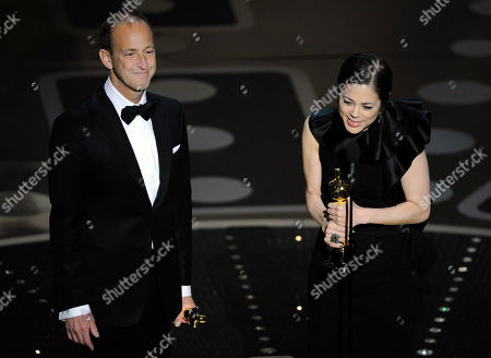 """Charles Ferguson, Audrey Marrs Charles Ferguson, left, and Audrey Marrs accept the Oscar for best documentary feature for """"Inside Job"""" at the 83rd Academy Awards, in the Hollywood section of Los Angeles"""