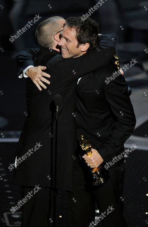 """Angus Wall, left, and Kirk Baxter accept the Oscar for best film editing for """"The Social Network"""" at the 83rd Academy Awards, in the Hollywood section of Los Angeles"""