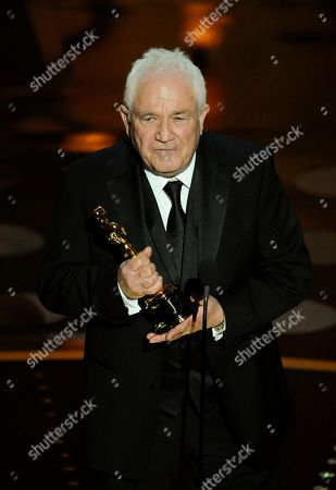 """David Seidler accepts the Oscar for best original screenplay for """"The King's Speech"""" at the 83rd Academy Awards, in the Hollywood section of Los Angeles"""