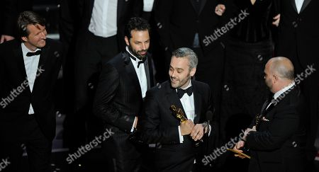 """Iain Canning is flanked by Emile Sherman, left, and Gareth Unwin as they accept the Oscar for best motion picture for """"The King's Speech"""" at the 83rd Academy Awards, in the Hollywood section of Los Angeles.At left is Tom Hooper"""