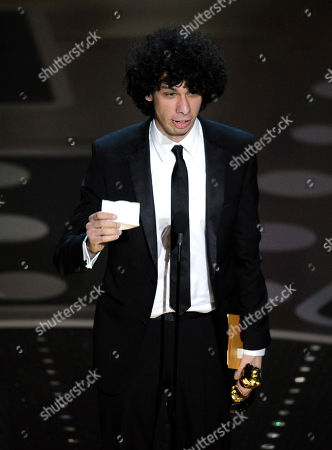 "Luke Matheny Luke Matheny accepts the Oscar for best live action short film for ""God of Love"" at the 83rd Academy Awards, in the Hollywood section of Los Angeles"