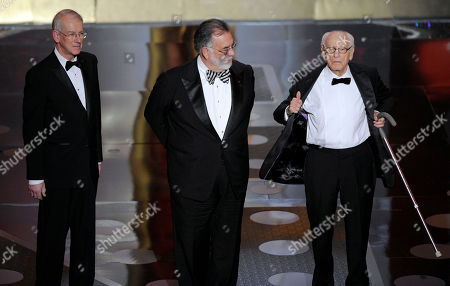 Stock Image of Kevin Brownlow, Francis Ford Coppola From left, film historian and preservationist Kevin Brownlow, director, producer, screenwriter, and Irving G. Thalberg Memorial Award recipient Francis Ford Coppola, and actor Eli Wallach are seen onstage accepting the governors awards during the 83rd Academy Awards, in the Hollywood section of Los Angeles