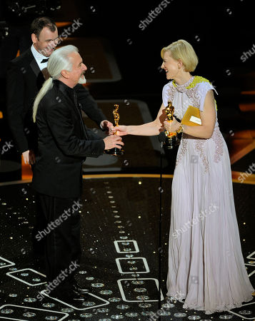 """Kate Blanchett gives Rick Baker, left, and Dave Elsey their Oscars for best makeup for """"The Wolfman"""" at the 83rd Academy Awards, in the Hollywood section of Los Angeles"""