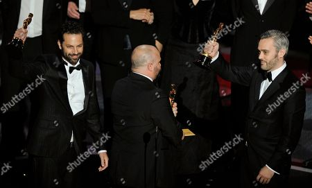 """Emile Sherman, left to right, Gareth Unwin and Iain Canning react as they accept the Oscar for best motion picture for """"The King's Speech"""" at the 83rd Academy Awards, in the Hollywood section of Los Angeles"""