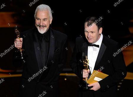 """Rick Baker, Dave Elsey Rick Baker, left, and Dave Elsey accept the Oscar for best makeup for """"The Wolfman"""" at the 83rd Academy Awards, in the Hollywood section of Los Angeles"""
