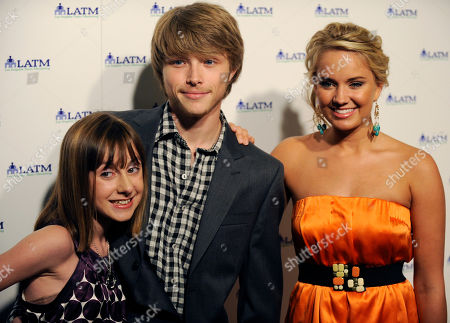 """Allisyn Arm, Sterling Knight, Tiffany Thornton Left to right, Allisyn Arm, Sterling Knight and Tiffany Thornton pose together at """"A Summer Soiree - The Magic of Mentoring,"""" a charity fundraiser for Los Angeles Team Mentoring, in Beverly Hills, Calif"""