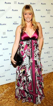 """Jennifer Tisdale Jennifer Tisdale arrives at """"A Summer Soiree - The Magic of Mentoring,"""" a charity fundraiser for Los Angeles Team Mentoring, in Beverly Hills, Calif"""