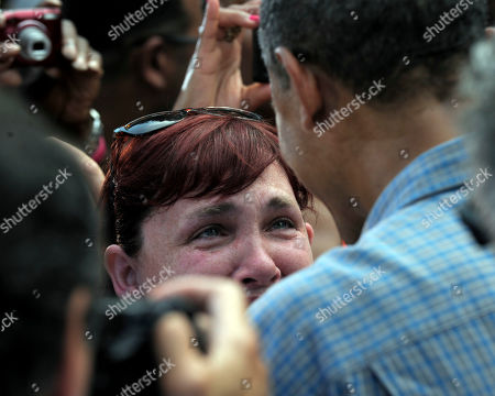 "Barack Obama, Stephanie Miller President Barack Obama, right, talks to Stephanie Miller after speaking at an ice cream social at Washington Park in Sandusky, Ohio, . Miller's sister, Kelly Hines, died from colon cancer four years ago. She could not afford proper health insurance, had no employer-provided coverage, and ""even after she was diagnosed with cancer, she was told her income was too high for Medicaid,"" Miller said. Miller thanked Obama for the getting the Affordable Health Act passed"
