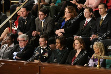 First lady Michelle Obama and guests listen as President Barack Obama gives State of the Union address on Capitol Hill in Washington, . Front row, from left are, Sabrina Simone Jenkins, Craig, Remsburg, Sgt. 1st Class Cory Remsburg, first lady Michelle Obama, Misty DeMars and Jill Biden. Second row, from left are, Jeff Bauman, Carlos Arredondo, Amanda Shelly, Nick Chute and John Soranno