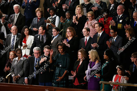 Micehlle Obama First lady Michelle Obama waves as she arrives for President Barack Obama's State of the Union address on Capitol Hill in Washington, . Front row, second from left are, Sabrina Simone Jenkins, Craig, Remsburg, Sgt. 1st Class Cory Remsburg, first lady Michelle Obama, Misty DeMars, Jill Biden, Kathy Hollowell-Makle, Aliana Arzola-Pinero and Joey Hudy. Second row, third from left are, Jeff Bauman, Carlos Arredondo, Amanda Shelly, Nick Chute, John Soranno, Estiven Rodriguez, and General Motors CEO Mary Barra. Third row, second from right are, Antoinette Tuff, and Moore (Okla.) Fire Chief Gary Bird, right