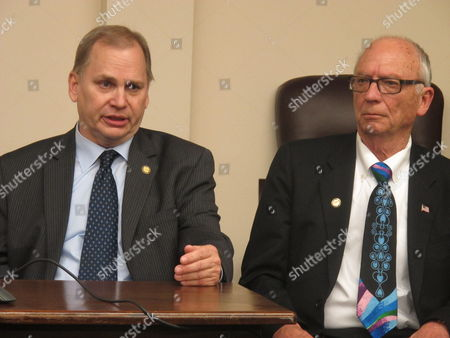 Alaska state Rep. Mark Neuman, left, speaks during a House majority news conference after legislators passed state operating and infrastructure budgets, in Juneau, Alaska. Seated beside him is Rep. Steve Thompson. Neuman and Thompson are co-chairs of the House Finance Committee