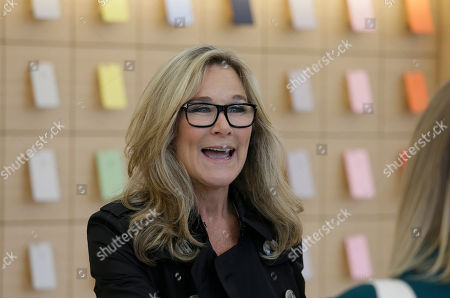 Angela Ahrendts Angela Ahrendts, Apple's senior vice president of Retail and Online Stores, visits with employees and reporters during a preview of the new Apple Union Square store, in San Francisco. Apple is getting ready to unveil a stylish new product that's not for sale, a new look for its stores. The iPhone maker is overhauling its nearly 480 stores worldwide, starting with its new location in San Francisco