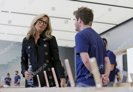 Angela Ahrendts Angela Ahrendts, Apple's senior vice president of retail and online stores, speaks with an employee during a preview of the new Apple Union Square store, in San Francisco. Apple is getting ready to unveil a stylish new product that's not for sale, a new look for its stores. The iPhone maker is overhauling its nearly 480 stores worldwide, starting with its new location in San Francisco