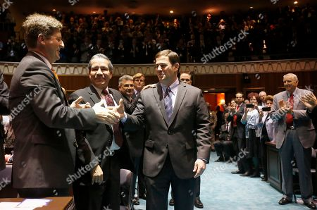 Doug Ducey, Roberto Rodiguez Hernandez, Greg Stanton Arizona Gov. Doug Ducey, middle, shakes hands with Phoenix Mayor Greg Stanton, left, as Roberto Rodriguez Hernandez, second from left, Mexico's Consul General in Arizona, looks, as Ducey arrives on the House floor to give his state-of-the-state address at the Arizona Capitol, in Phoenix