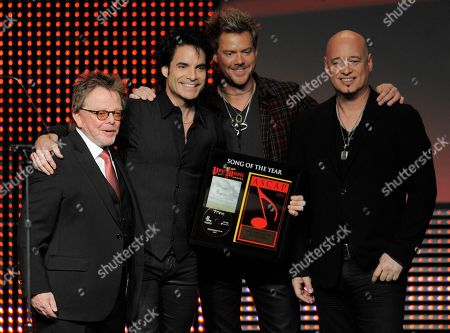 """Paul Williams, Pat Monahan, Jimmy Stafford, Scott Underwood Paul Williams, left, President and Chairman of the Board of ASCAP, poses with Train band members, from left, Pat Monahan, Scott Underwood and Jimmy Stafford after they won Song of the Year for """"Hey, Soul Sister,"""" during the 28th Annual ASCAP Pop Music Awards, in Los Angeles"""