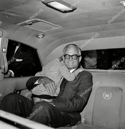Stock Image of Barry Goldwater, Cynthia Ross Republican presidential nominee Sen. Barry Goldwater, holds his sleeping granddaughter, Cynthia Ross, 4, in a car taking his party to their hotel in San Diego, Calif., after a whistlestop train trip south from Los Angeles, . The girl had fallen asleep on the train and the senator carried her off