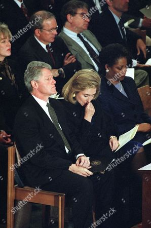 President Bill Clinton and first lady Hillary Rodham Clinton attend a memorial service for former Arkansas Sen. J. William Fulbright at the National Cathedral in Washington, . Behind the president is National Security Adviser Anthony Lake. Mary Ellen Baxter, wife of the Cathedral's Dean Nathan Dwight Baxter is at right. Fulbright died of a stroke. He was 89