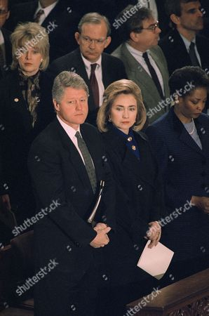 President Bill Clinton and first lady Hillary Rodham Clinton attend a memorial service for former Arkansas Sen. J. William Fulbright at the National Cathedral in Washington, . Behind the president is Martha Scott of the Arkansas State White House office and National Security Adviser Anthony Lake. Mary Ellen Baxter, wife of the cathedral's Dean Nathan Dwight Baxter is at right. Fulbright died of a stroke. He was 89