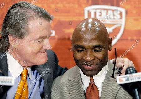 "Charlie Strong, Bill Powers Charlie Strong, right, is hugged by University of Texas at Austin President Bill Powers, left, during an NCAA college football news conference in Austin, Texas where Strong was introduced as the university's new football coach. Richard Lapchick, who has spent decades advocating for more diversity in sports, says, ""There's no question that the so-called prime jobs, programs with great traditions, have been less available to African-Americans."" He said it has been tougher for black coaches to build winning traditions because they usually get opportunities with losing teams, and it's tough to turn that around before the ax falls in two or three years. ""Stepping in at Texas or Penn State,"" Lapchick said, ""makes that a lot easier"